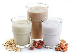 43263736 - different vegan milk: almond milk, hazelnut milk and oat milk